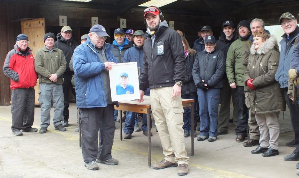 Chris presents Colin with a portrait